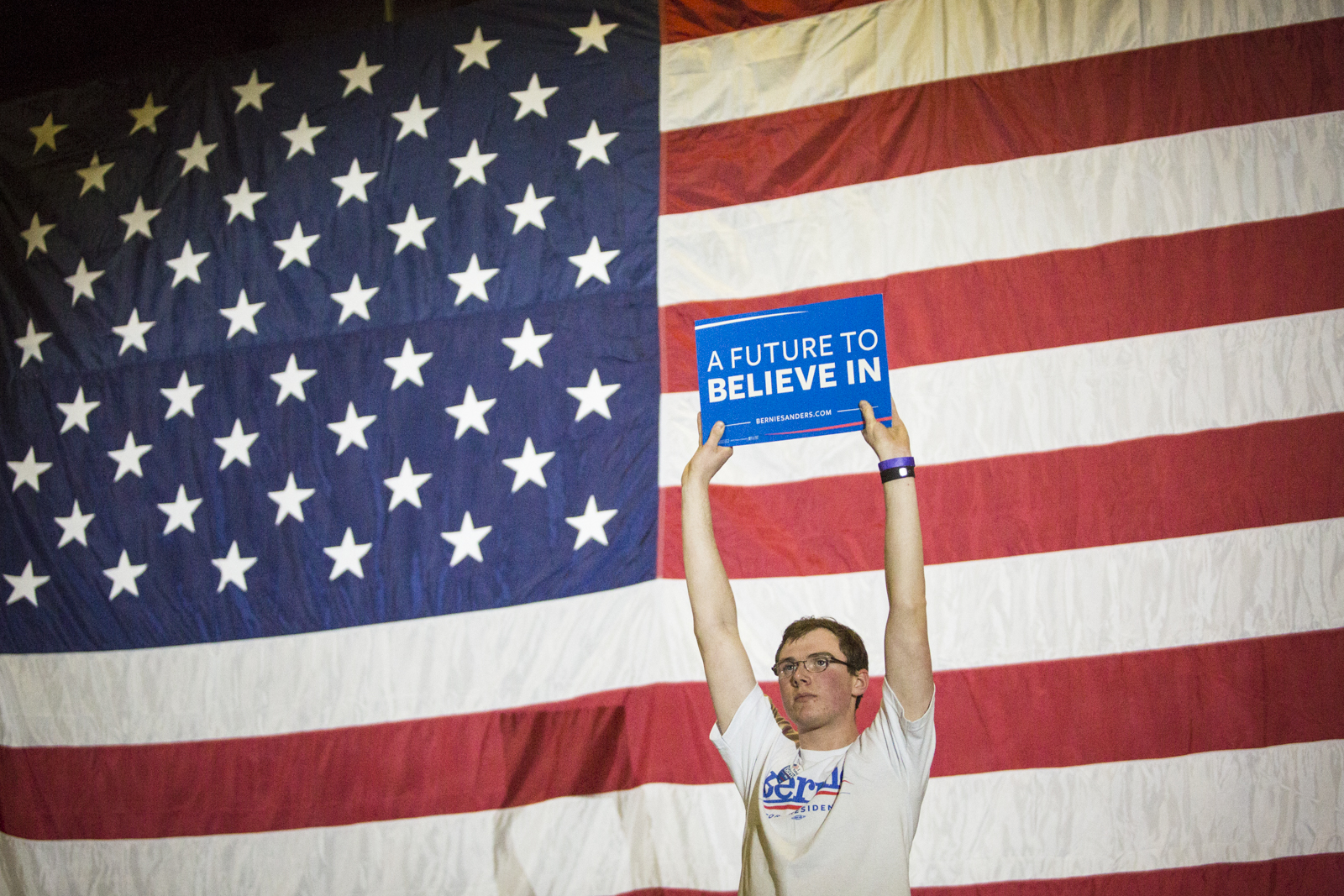 A Bernie supporter holds up a sign during Bernie Sanders' primary rally in Essex, Vermont on Tuesday, March 1, 2016. by Monica Donovan for Heady Vermont