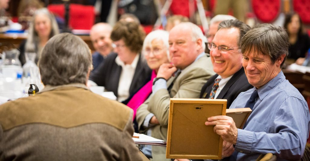 Member of the House Judiciary and Government Operations Committees listen to retired teacher Bruce Richards of Newbury speak out in favor of cannabis regulation at the Montpelier Statehouse public hearings on S.241 on Thursday, March 31 2016. by Monica Donovan for Heady Vermont.