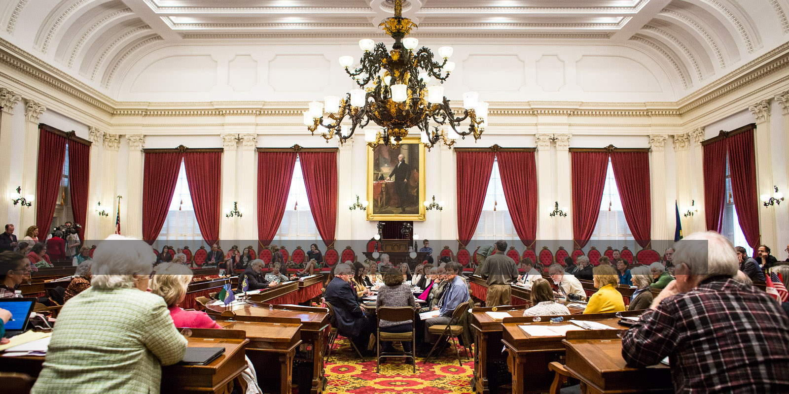 Members of the public listen during the Montpelier Statehouse public hearings on S.241 on Thursday, March 31 2016. by Monica Donovan for Heady Vermont.