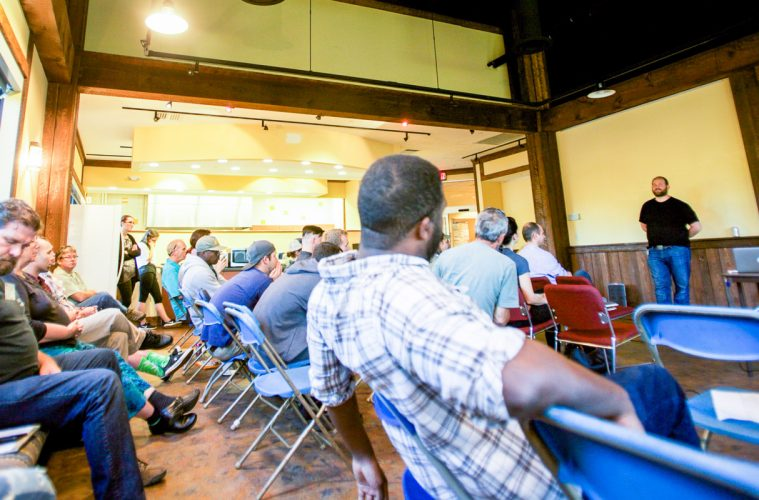 Attendees, including Champlain Valley Dispensary patients and employees, listen to a lecture about Cannabis and PTSD by Dr. Marcel Bonn-Miller, Ph.D at CVD Facilities in Milton, Vermont on Friday, October 7, 2016. by Eli Harrington for Heady Vermont.
