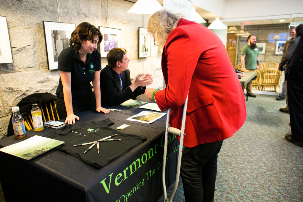 Exhibitors and attendees mingle at the Vermont Cannabis Solutions table during an Education Fair as part of Cannabis in the Capitol at the Vermont State House cafeteria on Tuesday, January 9. Photo by Monica Donovan for Heady Vermont